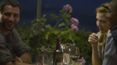 Friends in summer day evening are chattering at italian restaurant - stock footage