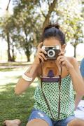 Woman taking picture, personal perspective Stock Photos
