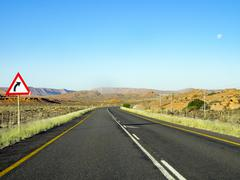 Street sign on empty road in South Africa, on the journey to Springbok Stock Photos