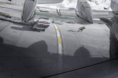 Reflection of ground crew in wing of A380 aircraft - stock photo