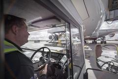 Tug driver towing A380 aircraft - stock photo