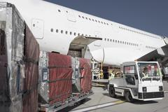 Ground crew loading A380 jet aircraft at airport Stock Photos