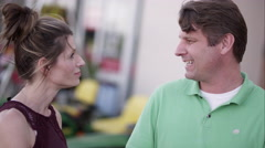 Man and woman shopping for lawnmower Stock Footage