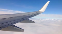 Aerial view over clouds from a plane - stock footage