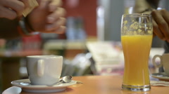 Young black man have breakfast with cappuccino ad orange juice Stock Footage