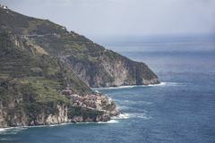 Elevated view of cliff village and Mediterranean, Cornelia, Cinque Terre, Italy - stock photo