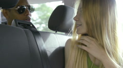Young beautiful blonde woman is chattering with a beautiful black man Stock Footage
