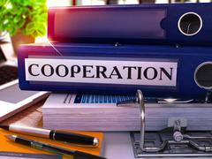 Blue Office Folder with Inscription Cooperation - stock illustration