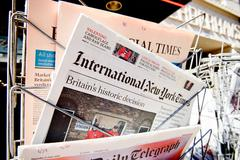 Major newspapers headline titles at press kiosk about the Brexit referendum Stock Photos