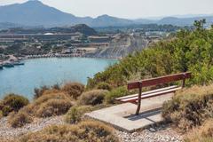 Kolymbia beach with the rocky coast in Greece. Stock Photos