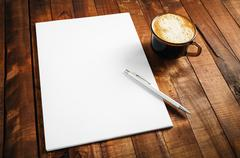 Photo of blank letterhead, coffee cup and pen Stock Photos