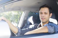 Man enjoying commute in comfortable car Stock Photos