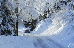 Car on snowy rural road, Monte Rosa, Piedmont, Italy - stock photo