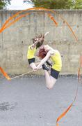 Young women practising ribbon dance on court Stock Photos