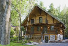 Luxurious Scandinavian cottage style log home facade in late spring, Quebec, Kuvituskuvat