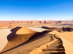Dune landscape at Sossuslvei in Namibia, View from the Big Daddy dune, links to - stock photo