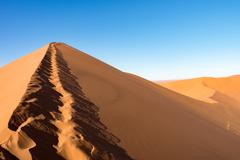 Ascent / descent of the Big Daddy dune to Sossusvlei - stock photo