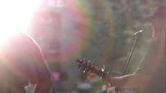View from behind band singing on stage Stock Footage