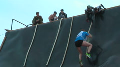 Sportsman storms big wall in extrim race. Tyumen - stock footage