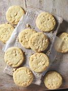 Overhead view of white chocolate chunk cookies on wood - stock photo