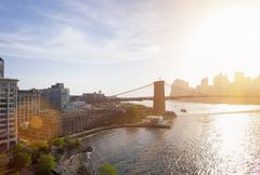 Elevated view of sunlit Brooklyn Bridge, New York, USA - stock photo