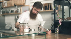 Preparation service concept of a handsome barista making coffee Stock Footage