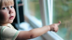 baby boy kid toddler child looking out the window and calling mama - stock footage