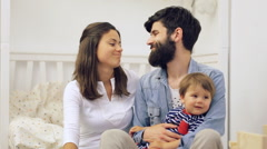 Happy family mother and father playing with a baby at home - stock footage