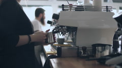 Barista operating coffee maker machine Stock Footage