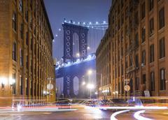 Manhattan Bridge and city apartments at night, New York, USA - stock photo