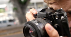 Man photographing with a camera Stock Footage
