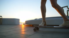 Close up male legs on longboard moving by seafront slow motion Stock Footage
