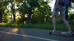 Handsome male skateboarding in sun light in park slow motion Stock Footage