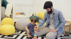 Father and child boy playing construction game together at home on the floor - stock footage