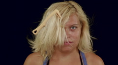 Funny blonde woman combing hair Stock Footage