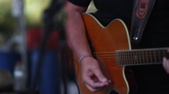 Up close view of man playing guitar and singing Stock Footage