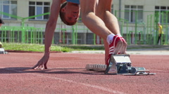 SLOW - A young athletes starting, feet level - stock footage