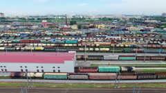 Railway yard with a lot of railway lines and freight trains, Rail freight Stock Footage