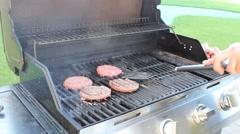 Grilling hamburger patties Stock Footage
