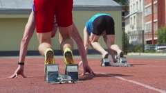 SLOW - A runner start from a starting blocks - back view Stock Footage