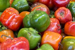 "Red, green and yellow chilli pepper from Peru called ""rocoto"" in a market. Natur Stock Photos"