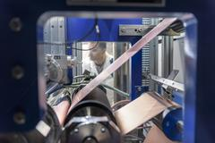 Manufacturing lithium ion batteries in battery research facility Stock Photos