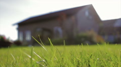 Shorn Lawn Sunlit Around the House Stock Footage