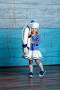 girl holding a life preserver - stock photo