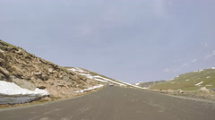 Car driving on paved road above timber line on Mount Evans-POV point of view. Stock Footage