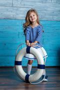 litl girl holding a life preserver - stock photo