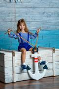 Child holding anchor Stock Photos