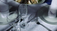 Empty wine glasses on a festive table in the restaurant Stock Footage