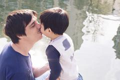 Father kissing little boy Stock Photos