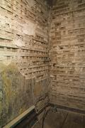 Partially demolished plaster and wooden lattice walls in a room inside an old - stock photo